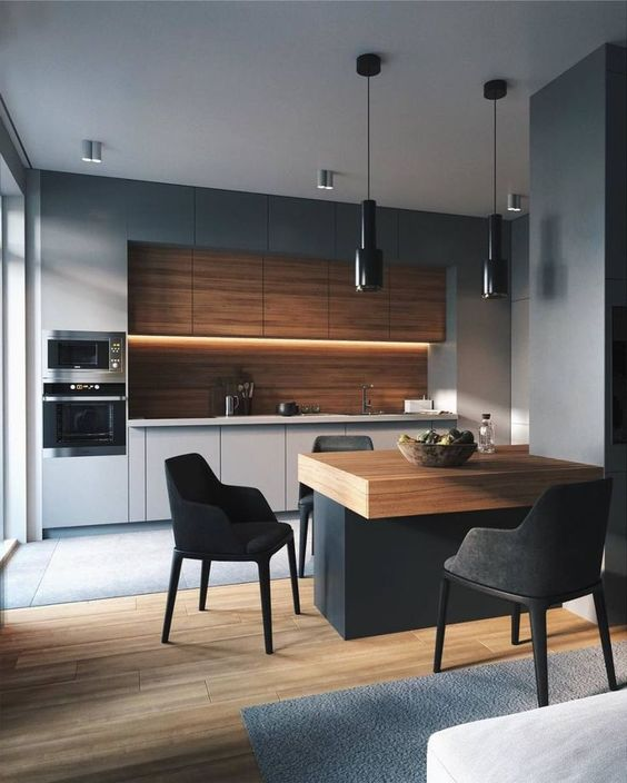 a minimalist grey kitchen with a wooden backsplash and upper cabinets plus a wooden countertop on the kitchen island