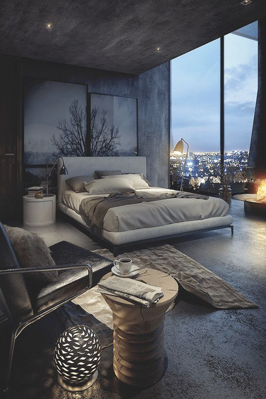 a minimalist industrial bedroom with a glazed wall, luxurious upholstered furniture, chic lamps and built-in lights