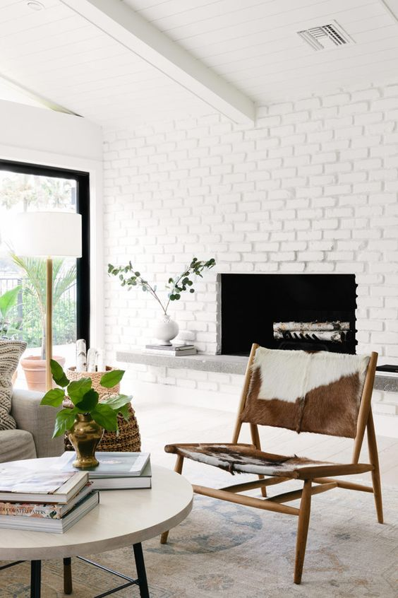 a modern farmhouse living room with a faux brick wall done with special panels, which is super easy to install
