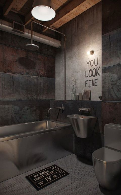 a modern industrial space with metal and concrete walls, exposed pipes, lamps and metal fixtures here and there