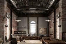 a moody industrial living room with red brick walls, a high ceiling with metal beams, leather chairs and sofas and wooden tables