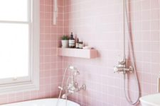 a pretty light pink bathroom with white appliances and vintage fixtures looks very girlish and very cute