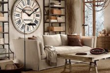 a rustic industrial living room with concrete walls, a wooden table, metal shelving units, a large clock and some metal gears