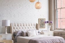 a stylish feminine bedroom accented with a white brick wall that makes it less sweet and gives a bit of industrial feel