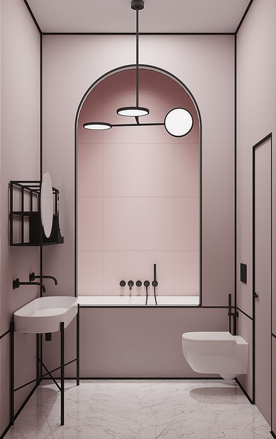 a tender blush bathroom with black touches for drama and white appliances to refresh the space - a chic combo