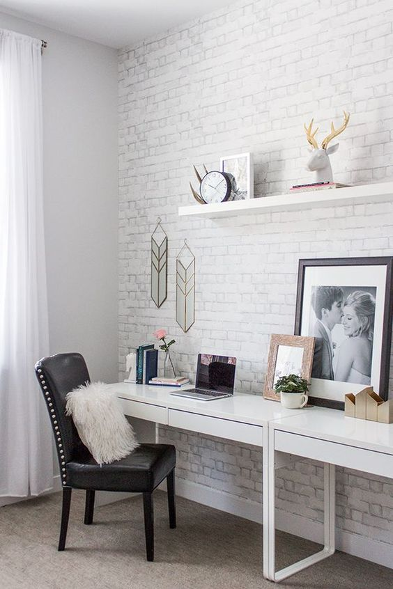 a whitewashed brick wall makes this neutral modern space more stylish and chic, you can make it real or faux
