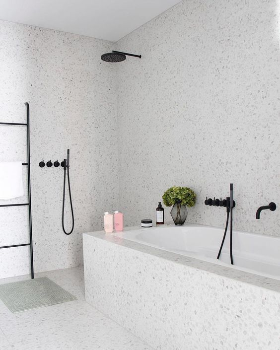 an airy and serene grey bathroom done with terrazzo, with black touches for a more modern feel