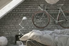 an attic industrial bedroom with grey brick walls, a pallet bed, a metal floor lamp and paper lamps