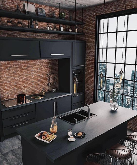 a modern kitchen with brick walls that looks amazing