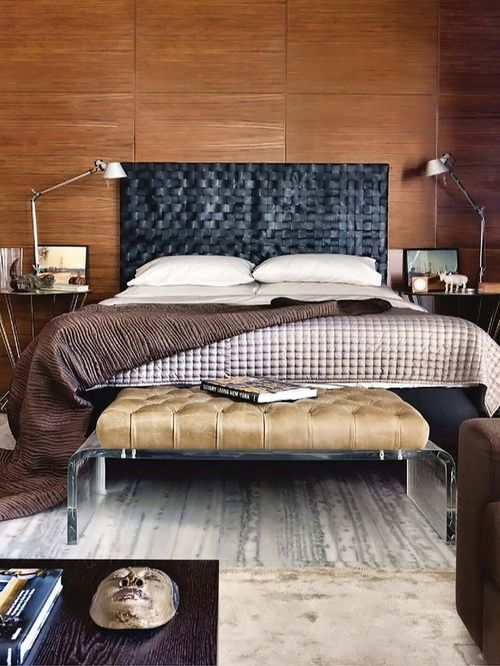 a black woven leather headboard and an acrylic bench with a light brown leather seat for an edgy look