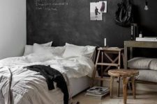 02 a chic bedroom in Nordic style, with rustic wooden furniture, an accent chalkboard wall and simple bedding