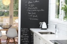 05 a pure white kitchen with a chalkboard wall to note recipes and various stuff you want to note
