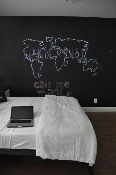 a simple and casual bedroom with a statement chalkboard wall that cna be used for any kinds of art