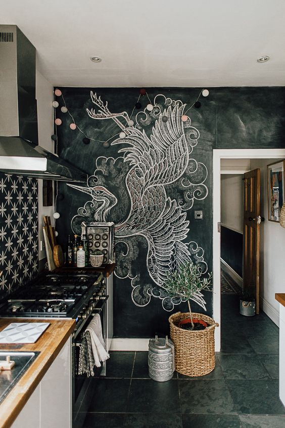 a chalkboard wall with a large art   use your chalkboard not only as a note board but also for art