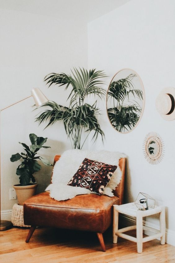 a comfy brown leather chair with a faux fur cover for a boho feel is a perfect piece for a reading nook