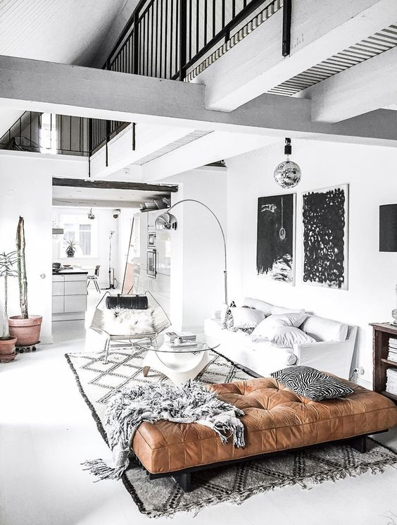 a Nordic space in black and white with a warming up touch - a brown leather daybed, which is perfect to enjoy a nap