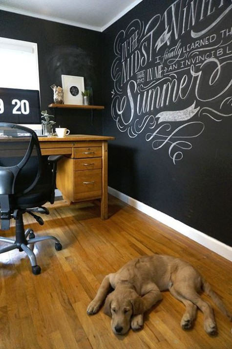 a farmhouse home office with all chalkboard walls to create art, marks and other stuff on the walls