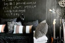 09 an accent chalkboard wall matches the black forged bed and is used for formulas and necessary things not to forget