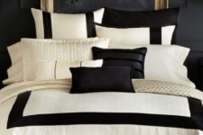 10 an elegant bedroom with a chalkboard wall, a gold refined frame, a crystal chandelier and black and white bedding
