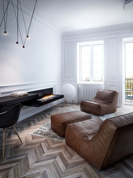 a minimalist living room with a wlal-mounted fireplace, a black desk and brown leather furniture for an eye-catchy look