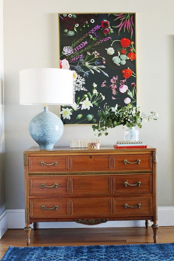 a moody floral artwork with realistic blooms looks very refined and will spruce up any space