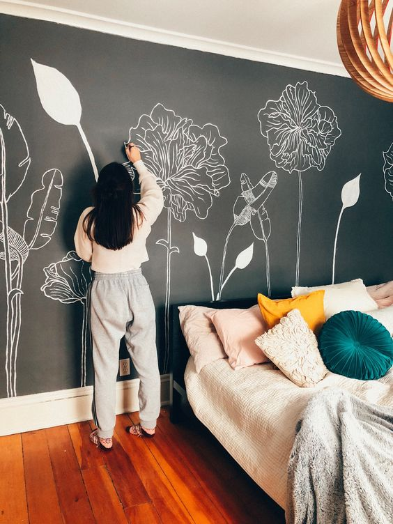 make your bedroom super cool rocking a chalkboard accent wall and chalking some blooms and plants on it