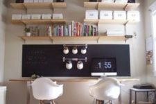 13 a double home office and study space with a single chalkboard piece that is used both for notes and for attaching railing