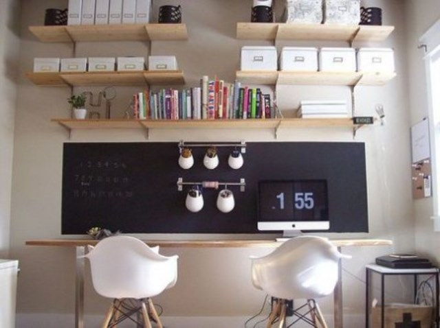 a double home office and study space with a single chalkboard piece that is used both for notes and for attaching railing