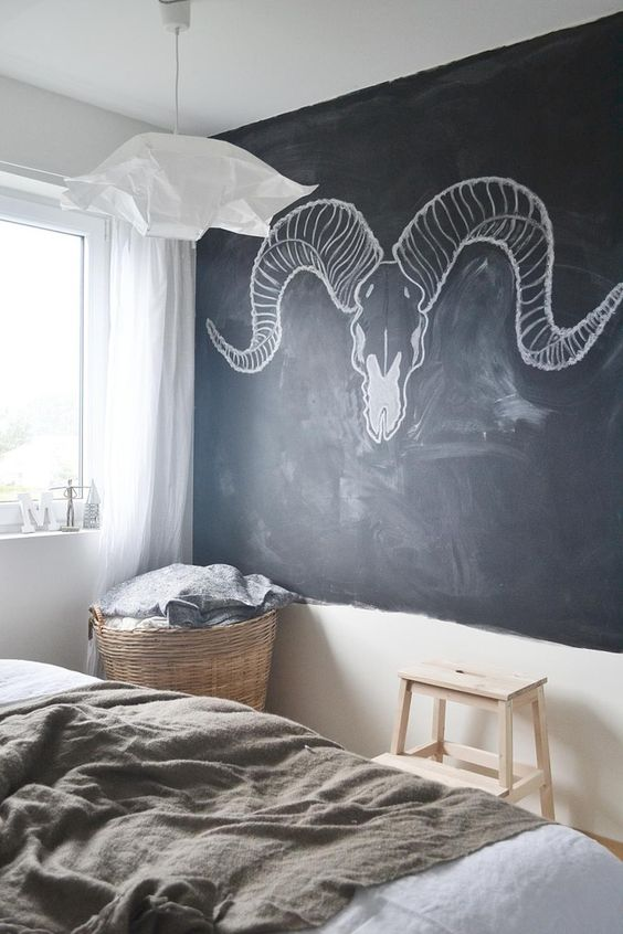 spruce up your bedroom design with a chalkboard wall and some design or art on it to make it more pesonalized and catchy