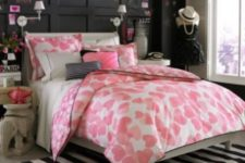 15 a girlish bedroom with a paneled chalkboard wall, a striped rug, quirky furniture, touches of pink looks very cute
