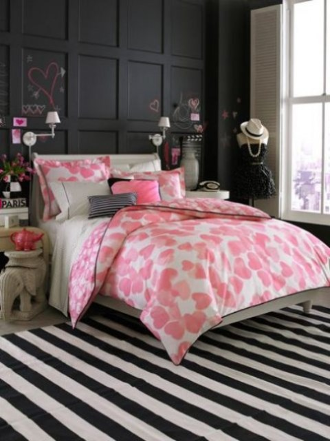 a girlish bedroom with a paneled chalkboard wall, a striped rug, quirky furniture, touches of pink looks very cute