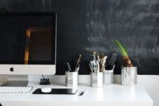 15 a monochromatic home office with a chalkboard wall for making marks and notes and to match the color scheme