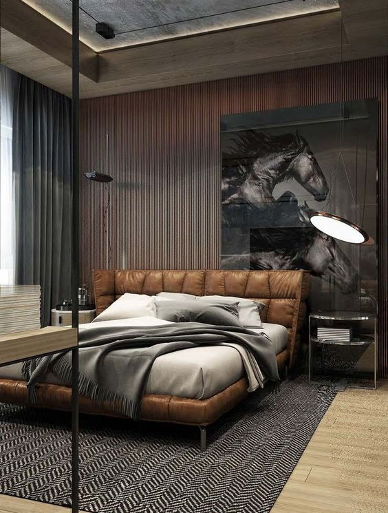 an edgy masculine bedroom with a wood slab wall, a weathered wooden ceiling and a brown leather bed