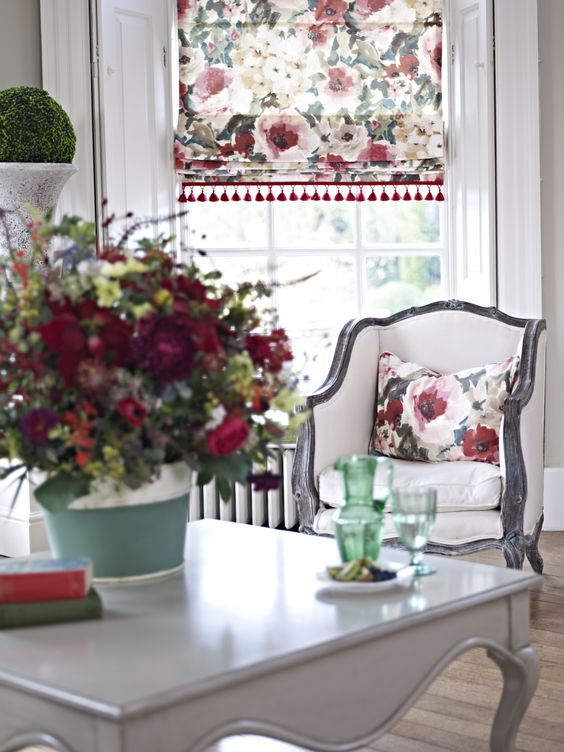 floral Roman shades and a small pillow for a refreshing summer feel in your dining room