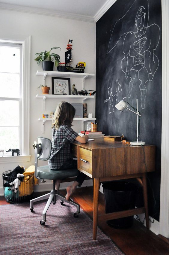 a chalkboard accent wall in a kid's bedroom is a great idea - your kid will create art, leave notes and other stuff on it
