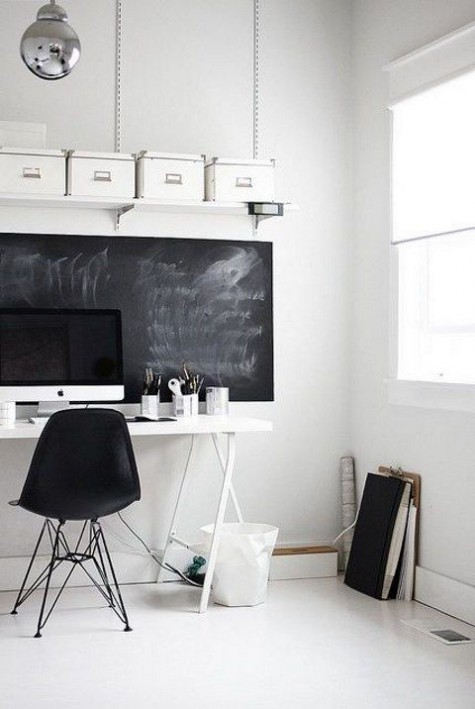 a Nordic home office mostly in white, with a chalkboard statement that can be used as a memo board
