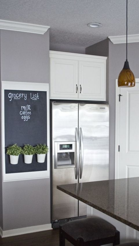 a chalkboard sign grocery list with a rail for hanging cutlery or some herbs in pots is a perfect idea for any kind of kitchen