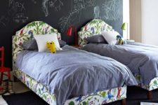 17 a double kid bedroom with a chalkboard wall for art of all kinds, with colorful beds and furniture for a lively feel