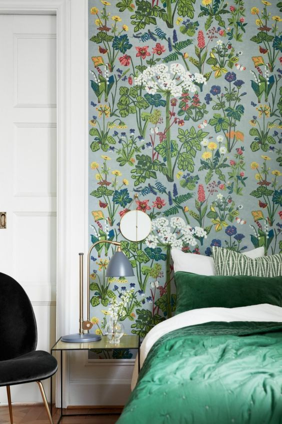 such colorful wildflower print wallpaper is a great idea for a statement wall in a bedroom