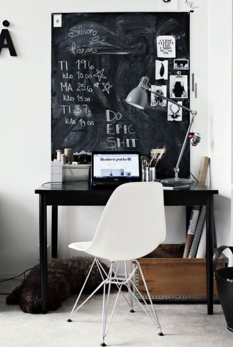 a Nordic home office with a large chalkboard used as a memo board, wiht pics, notes and other stuff