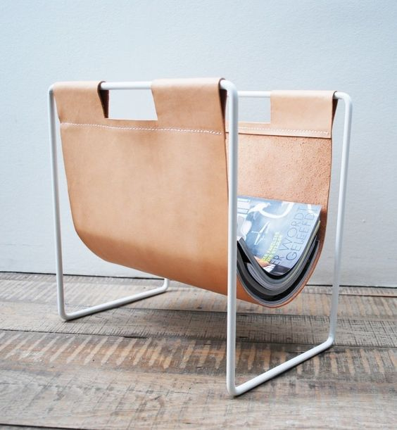 a stylish leather magazine holder on metal piping can be DIYed by you yourself and will hold everything you need