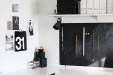 20 a Scandinavian home office with a chalkboard for making marks and a gallery wall in black and white