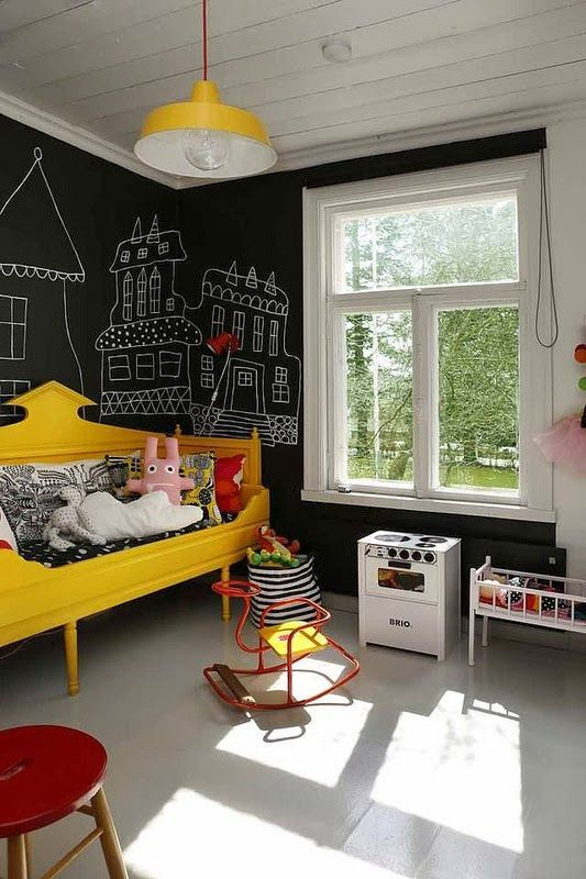 a modern kid's bedroom with chalkboard walls allows chalking everywhere your children want without spoiling anything
