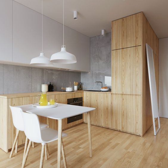 a clean minimalist kitchen feels cozy and fresh, and wood makes it more inviting and welcoming
