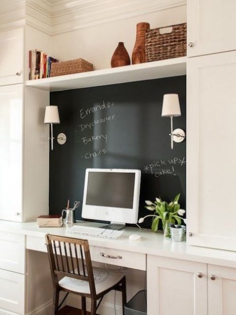 a small home office nook with a chalkboard piece that is used as a memo board - for marks, notes and other stuff, a great way to declutter the space