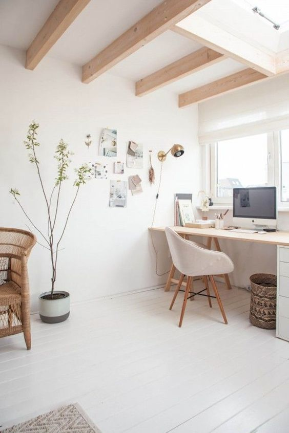 a clean and minimal home office in neutrals, with wooden furniture and wooden beams on the ceiling