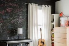 23 a small bedroom for a creative person with a chalkboard wlal for art and messages, with all white everything to fill the space with light
