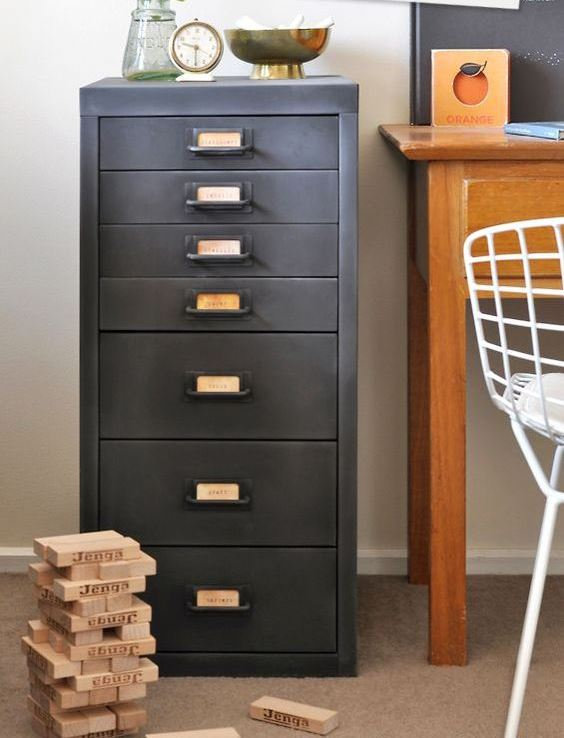 a vintage filing cabinet refinished with chalkboard paint that gives it a worn and very refined vintage feel
