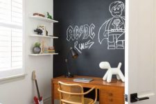 25 a small yet inviting kid's bedroom with a chalkboard wall and stylish furniture is a very cool space for the little owner