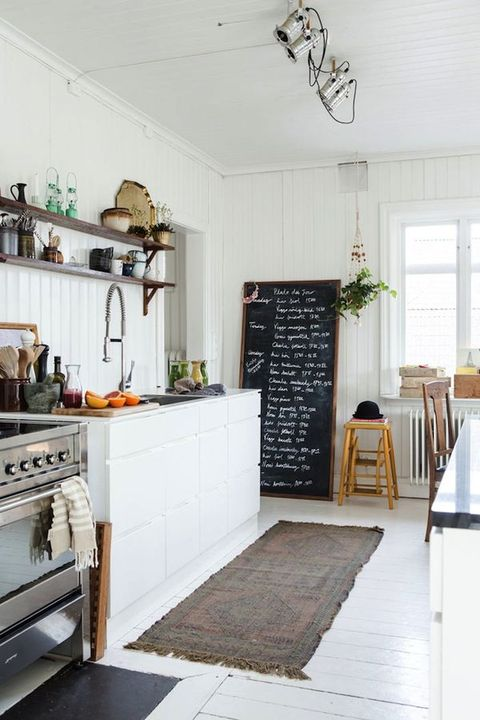 a white Nordic kitchen with an oversized chalkboard sign that you can bring to make notes and marks of all kinds
